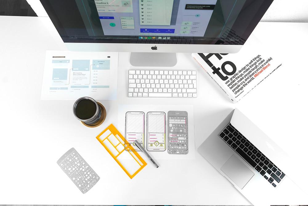 organized desk with design tech