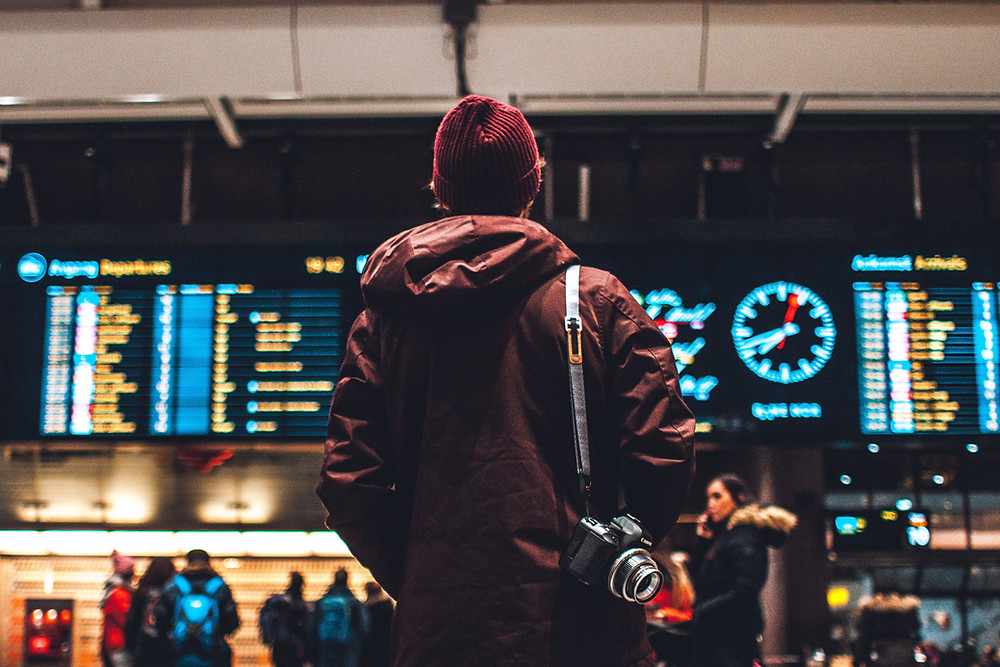 Traveler standing in an airport