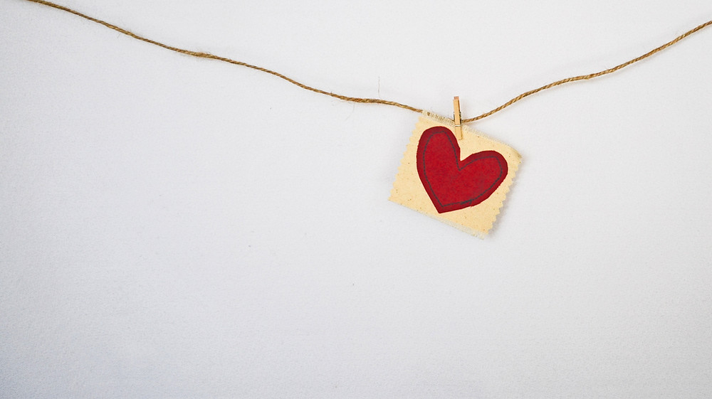 heart card clipped on a hanging string