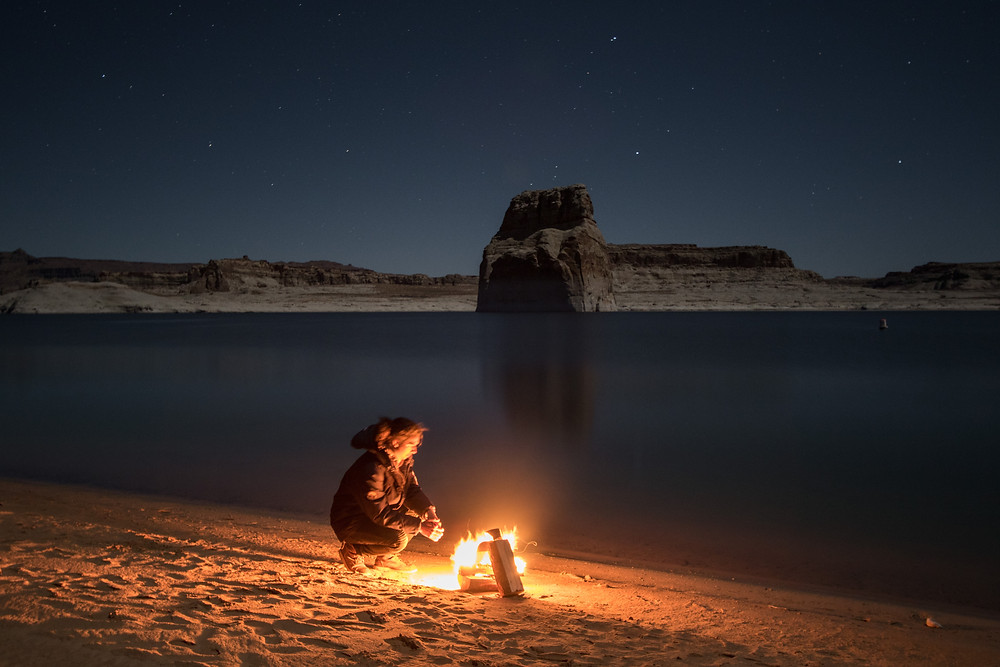 a fire on the beach of lake powell