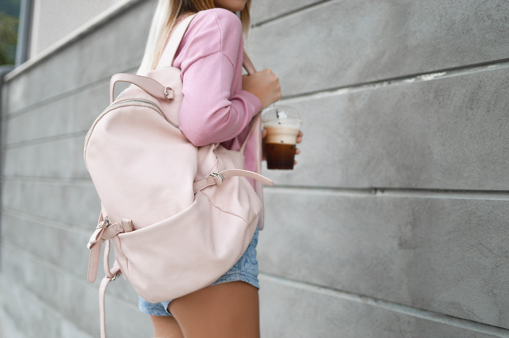 Girl student wearing pink backpack