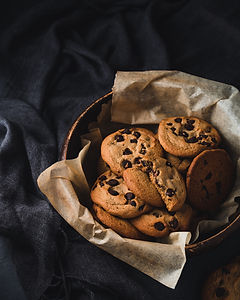 Chocolate chip cookies in a biscuit barrel