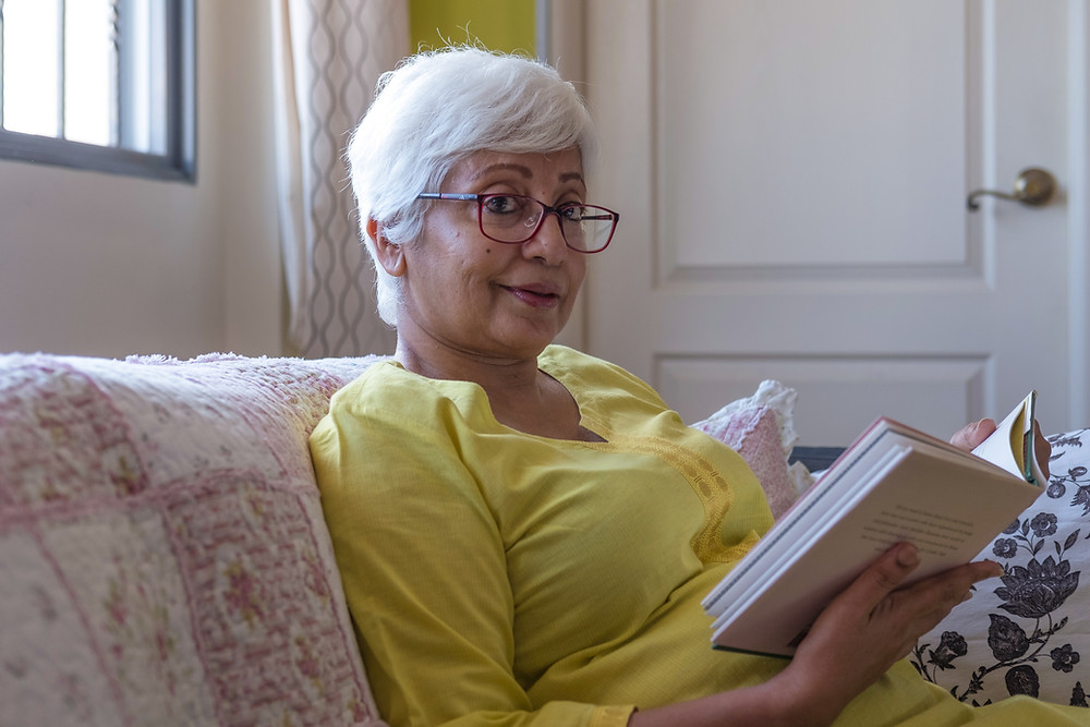 elegant-older-woman-reading-book