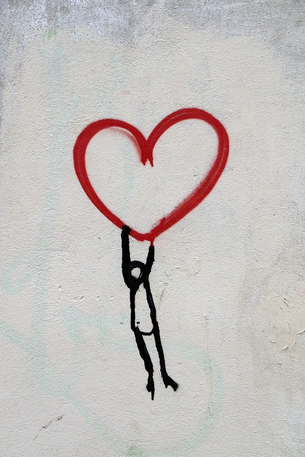 Stick figure hanging from heart drawing