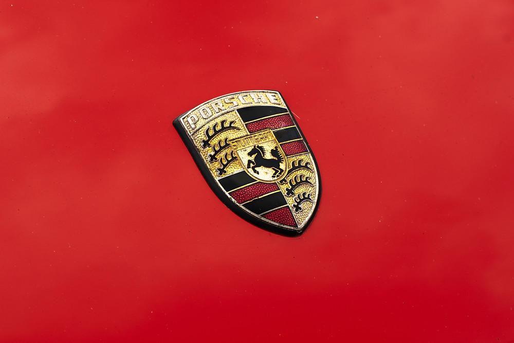 red is an exciting colour for logo design as Porsche's logo shows