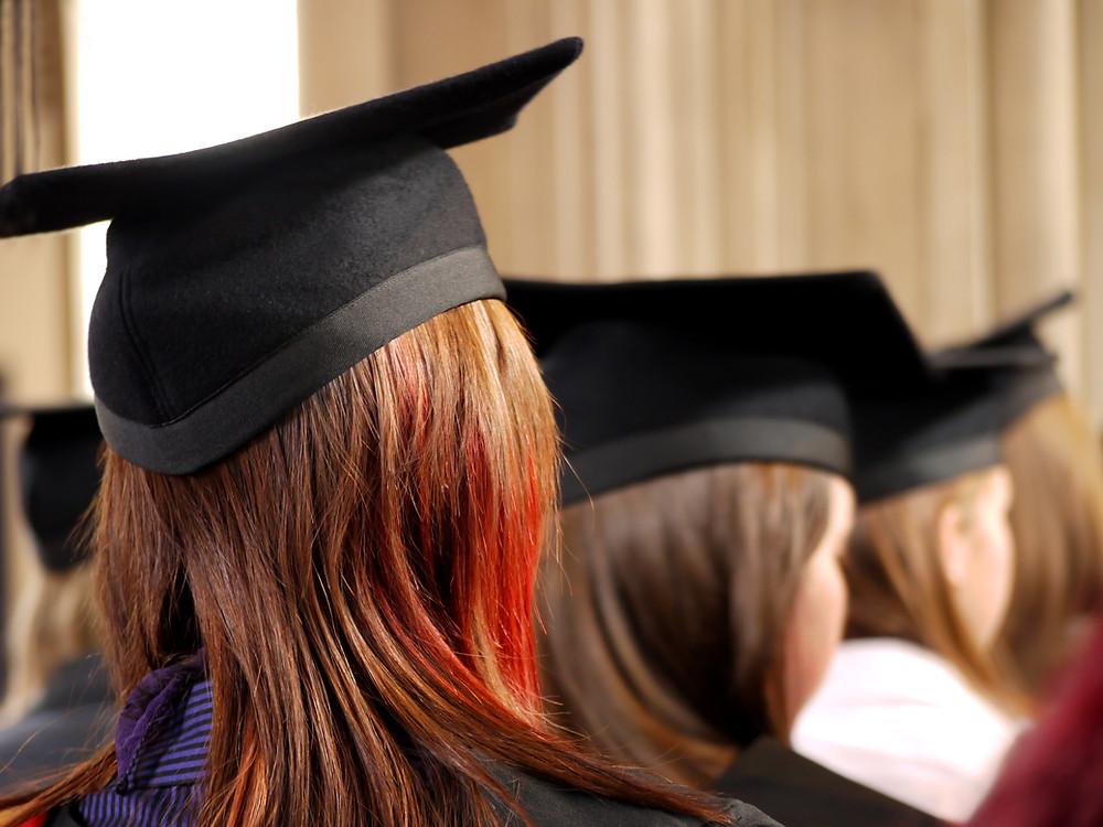 A woman wearing a graduation cap.