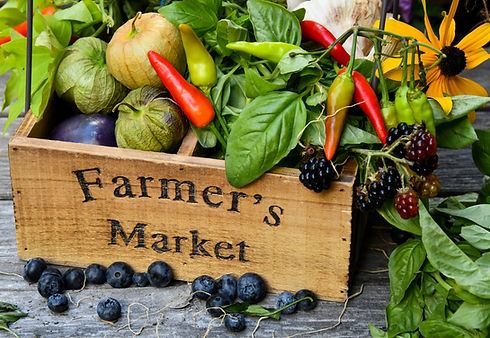 farmer's market box full of vegetables