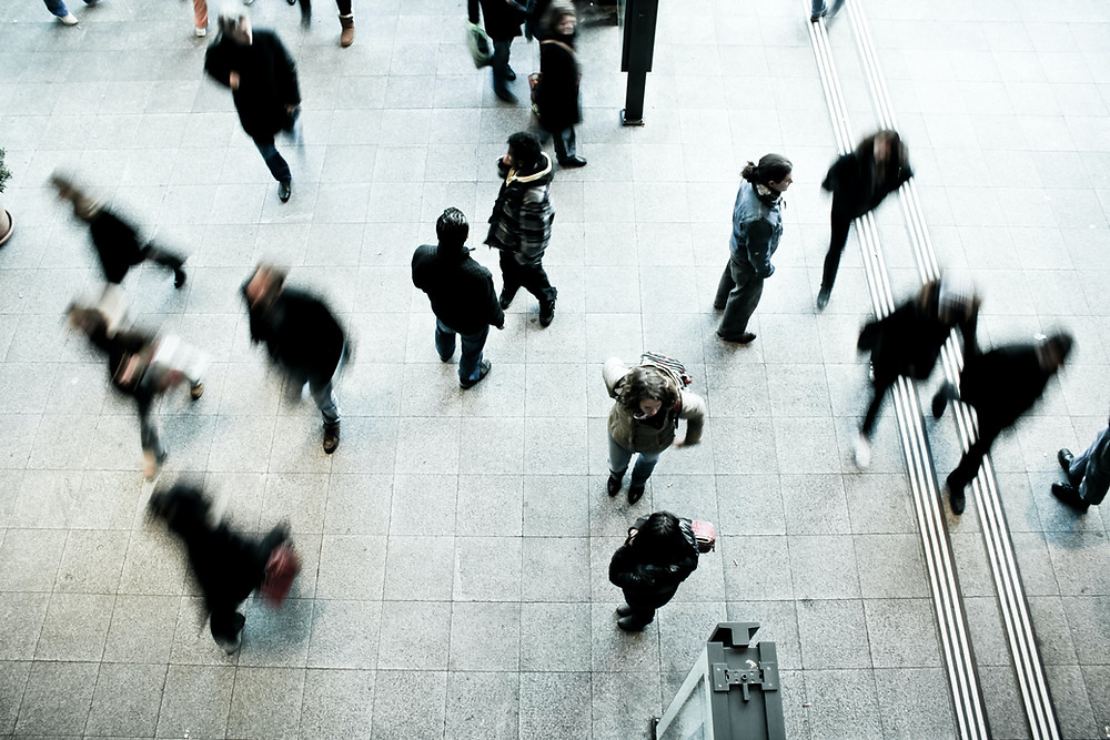 soul contract - birds eye view people walking on concrete pavement