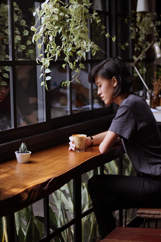 woman sitting alone drinking tea