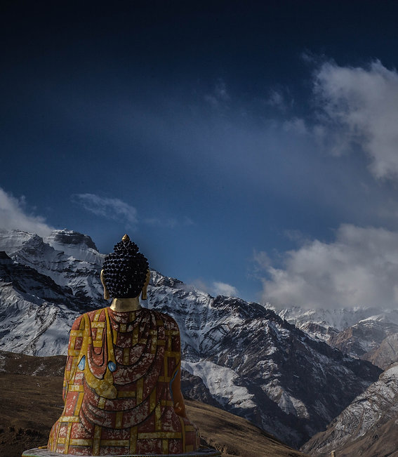 Image by Sayan Nath. Peaceful buddha statue meditating mountains and snow