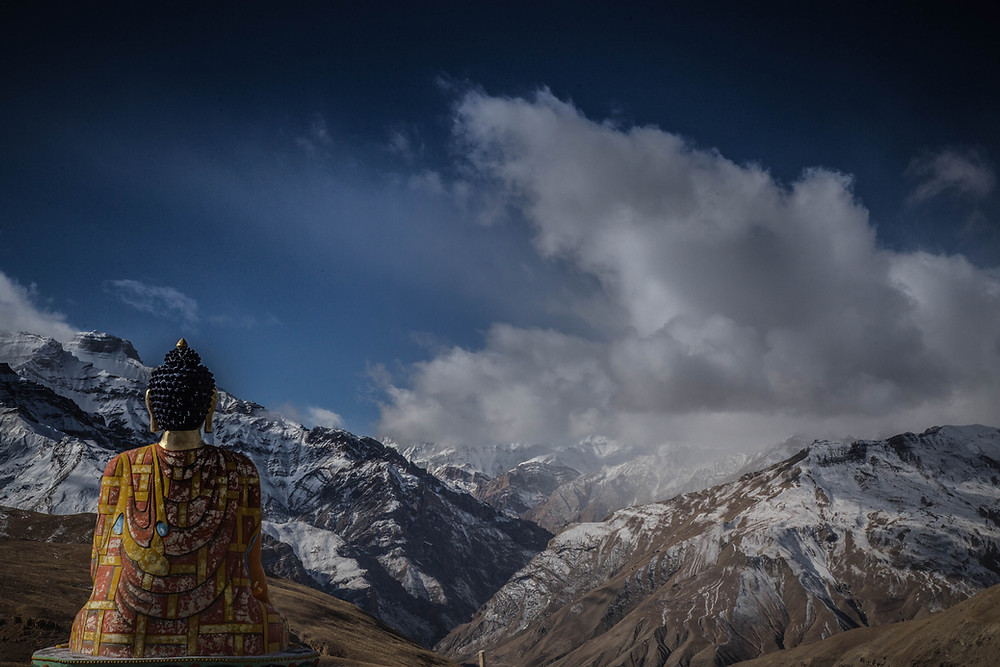mountains buddha statue sky clouds