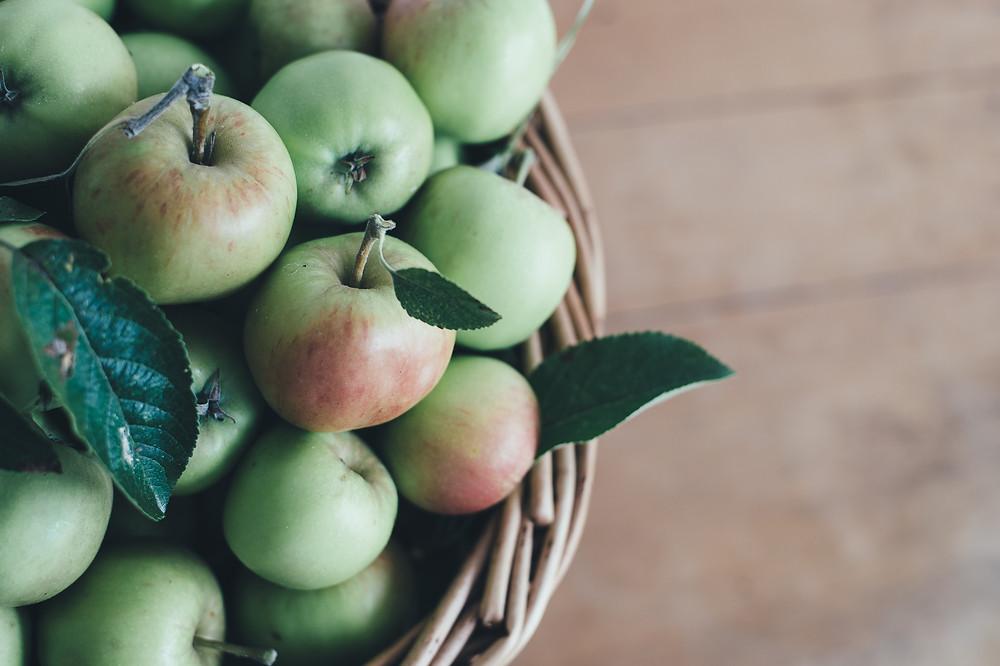 A basketful of green apples.