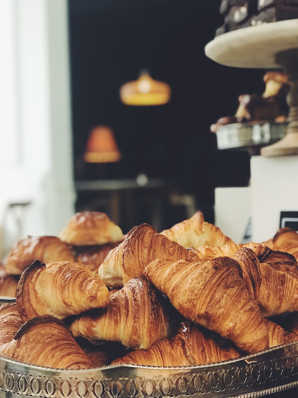 A stack of croissants in a bakery tray