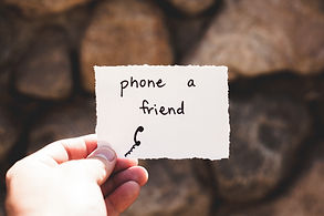 hand holding phone a friend note