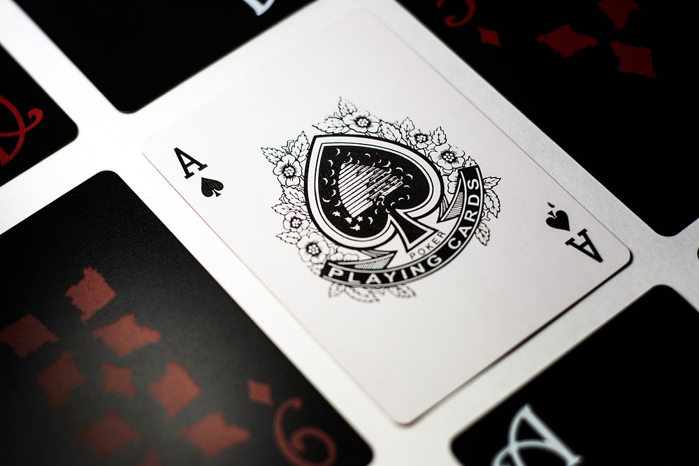 ace of spades surrounded by other cards