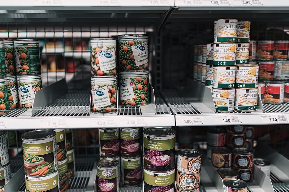 Canned vegetables on supermarket shelves