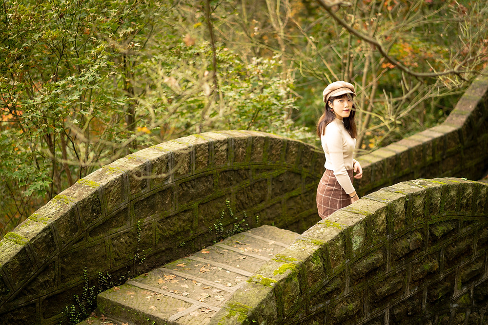 Woman on mossy bridge