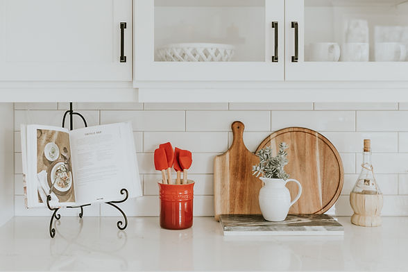kitchen counter with cooking utencils and a recipe book