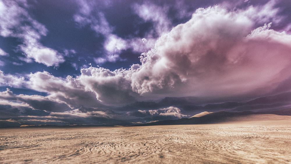 bright stormy clouds over a desert