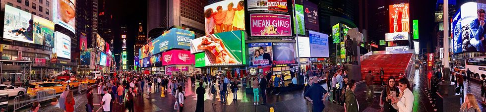 Various types of digital signage advertisements in Times Square, New York.