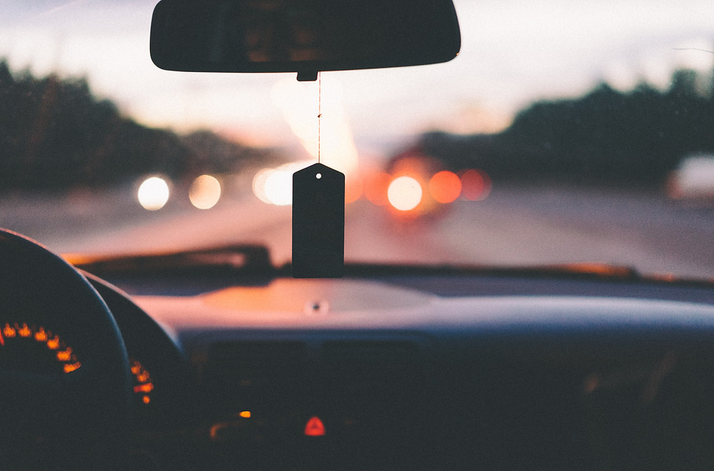 Driving Test Nerves, Car driving late at night on a busy road. Picture by A.L. at Unsplash