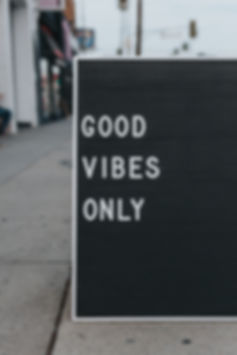 A BOARD SAYS GOOD VIBES ONLY