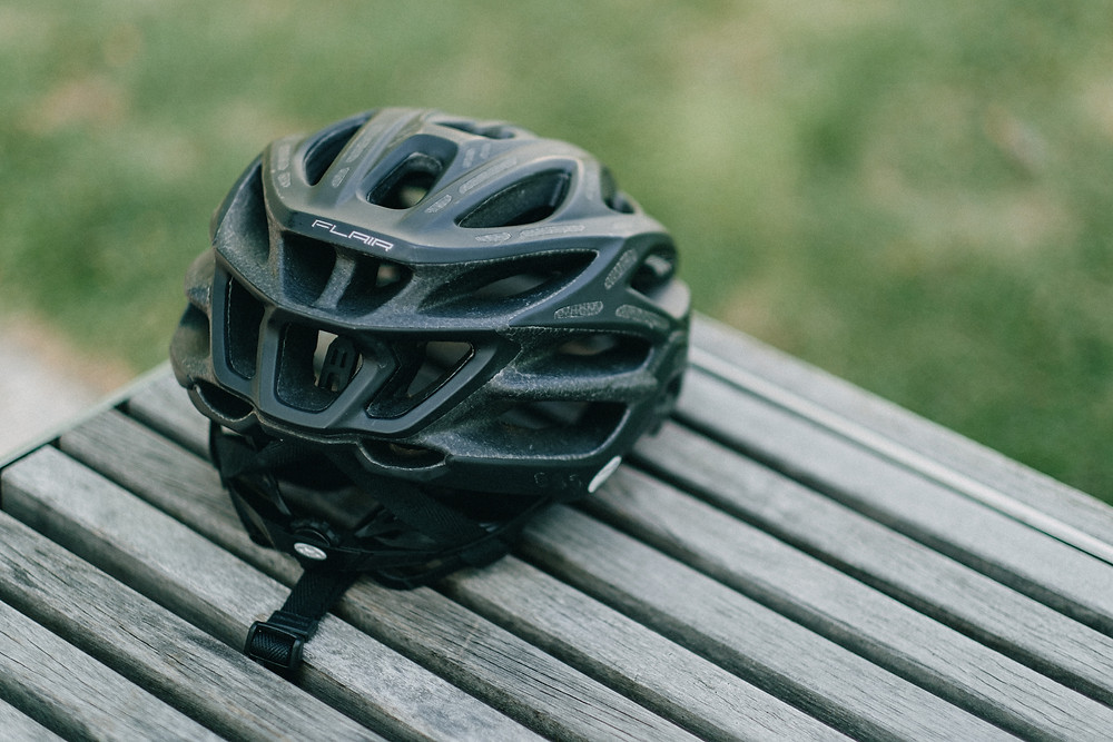 Cycling helmet on a picnic bench