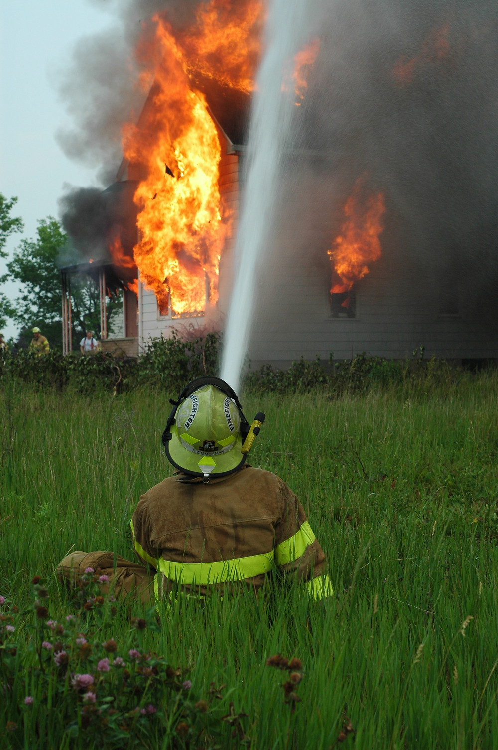 Fireman putting out financial fire