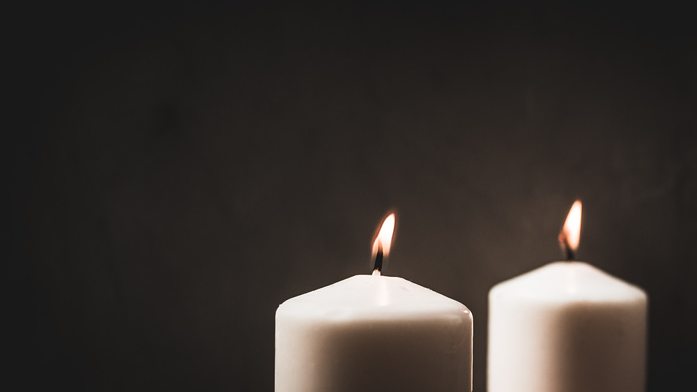 two candle flames burning twin flame