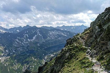 Hike the beautiful mountainscapes of the Polish Carpathians, the Tatra Mountains, located on the border of Poland and Slovakia on this one-week adventure walking holiday.   Starting in medieval Krakow, we take a short drive to Babia Gora National Park where our first walks will lead us across alpine meadows and through  ancient forests, in this place that has been described as a meeting place of witches. Next we enjoy some spectacular mountain views as we walk from Slovakia back into Poland and base ourselves in Zakopane, a popular hike and ski resort in the foothills. We hike through the beautiful valley of the Five Polish Lakes before we have the option to attempt the challenging ascend of Kozi Wierch (2,291m) where we are rewarded with more incredible views.  A highlight for many is the walk along the Pieniny Way through the stunning Dunajec Gorge, winding its way along the border between Slovakia and Poland. Finally we take a traditional wooden boat across the Dunajec River to enjoy a day of hiking and more wonderful views as we summit Trzy Korony (982m) in the Three Crowns range.