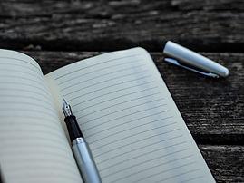 pen in blank notebook