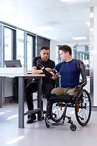 Technician fitting robotic arm to patient - image by ThisisEngineering RAEng