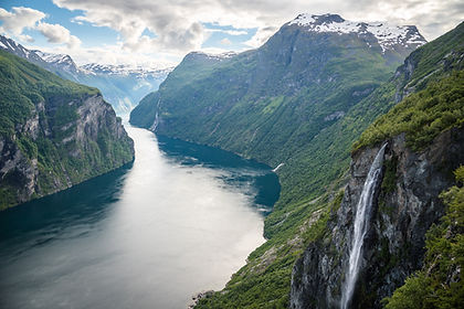 Join us on a tour showing you the best of Norway from south to north.  Start in the capital Oslo before travelling by train to Lillehammer, host of the 1994 Winter Olympics.  Next we travel through the highlands and lush valleys of Gudbrandsdalen to Lom, famous for its 12th century Stave Church.  We use Lom as a base to take a boat trip on the spectacular Geirangerfjord before travelling by vehicle and ferry through spectacular mountain and fjord country to the peaceful village of Aurland.  Here you have a full day to relax, hike or simply taking in the views of the fjord and surrounding gardens.  From Aurland we travel to Flåm to board the famous Flåm  Railway, rated as one of Europe's best rail journeys due to its many scenic views of fjords and mountains.  Disembarking ato Myrdal Station, we take an express boat on Norway's longest fjord, the Sognefjord, to Bergen.  After a day in this lively Hanseatic town we board the coastal ferry system for a 5-day cruise along the stunning westcoast of Norway.  Navigating past island and through channels and fjords, we visit such highlights as Ålesund, famed for its art nouveau architecture and historic Trondheim with its Nidaros Cathedral.  Cross the Arctic Circle to reach the stunning Lofoten islands, Arctic Tromsø, the North Cape, one of the northernmost points on the European continent, and finally Kirkenes, hard-up against the Russian border.  While on board the ship there are options to make excursions to visit lively towns, picturesque fishing villages, Svartisen glacier, a Viking Museum and visit with the indigenous Sámi people.