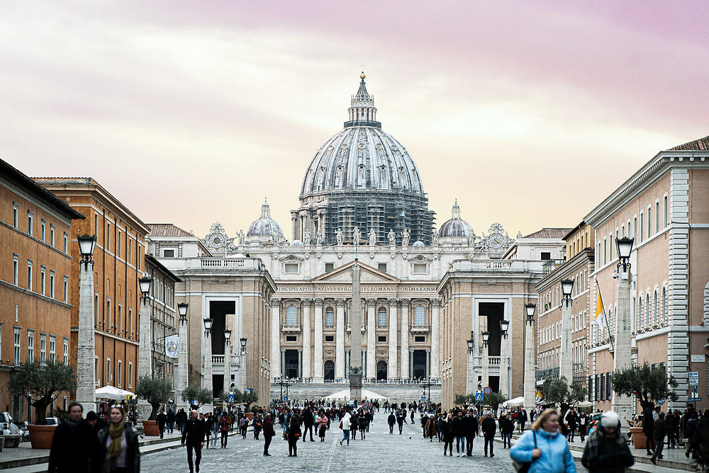 the vatican in the early evening with a pink sky in the background.