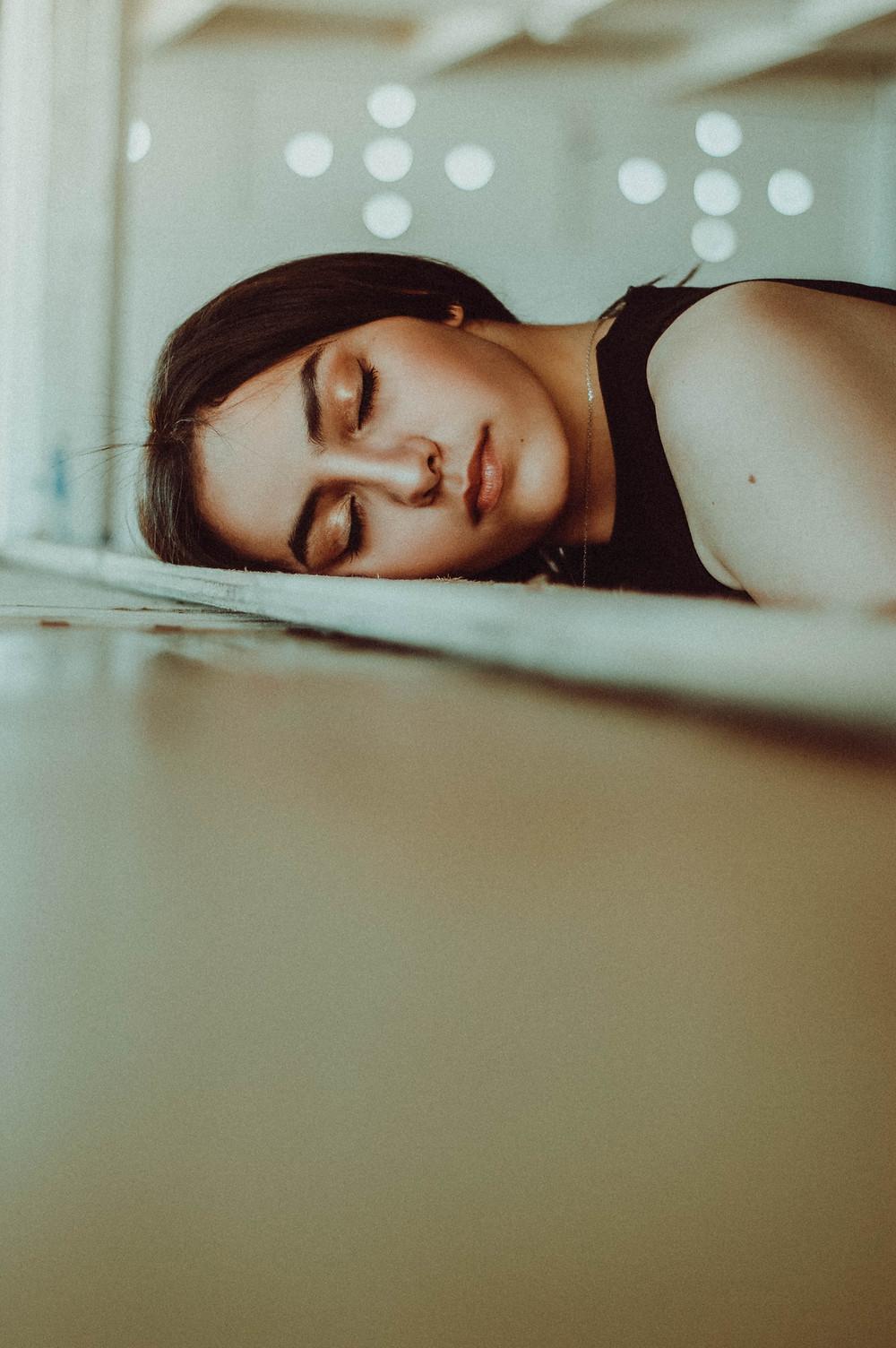 woman falling asleep during test
