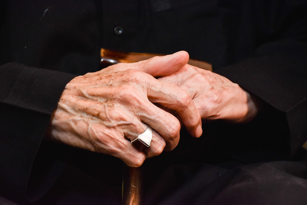 Aging hand on cane
