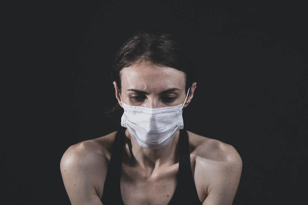 Woman's anxiety worsens due to the Covid-19 pandemic. Catalyss Counseling provides treatment for depression in Colorado through online therapy and in person counseling in the Denver area 80209 and 80210