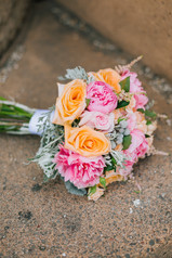 Peach and cerise bridal bouquet