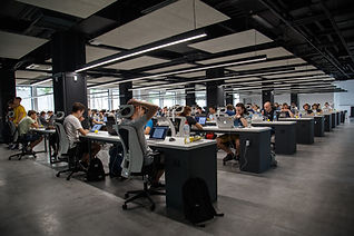 Large open workspace with lots of desks