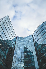 This image is a frontal view of a glass building.
