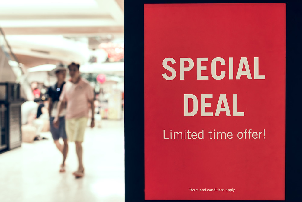close up of red poster in store stating special deal, limited offer