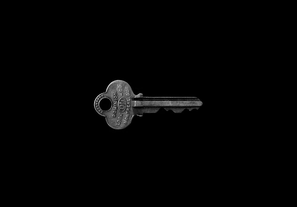 old metal key close up macro shot black background