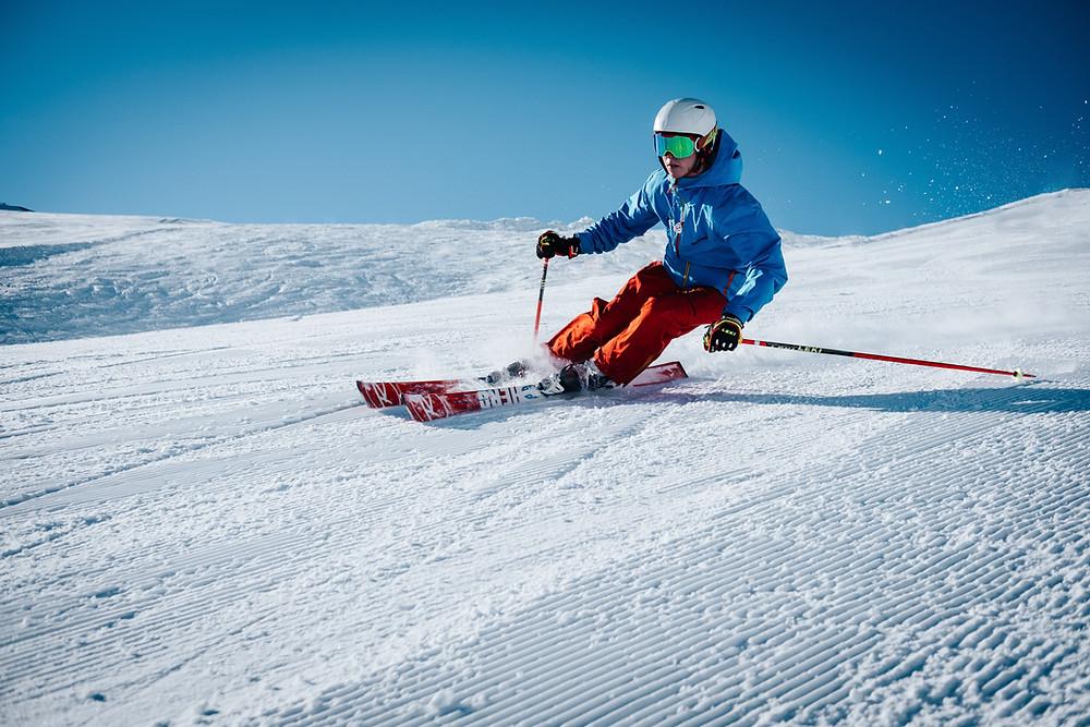 Man snow skiing down the mountain
