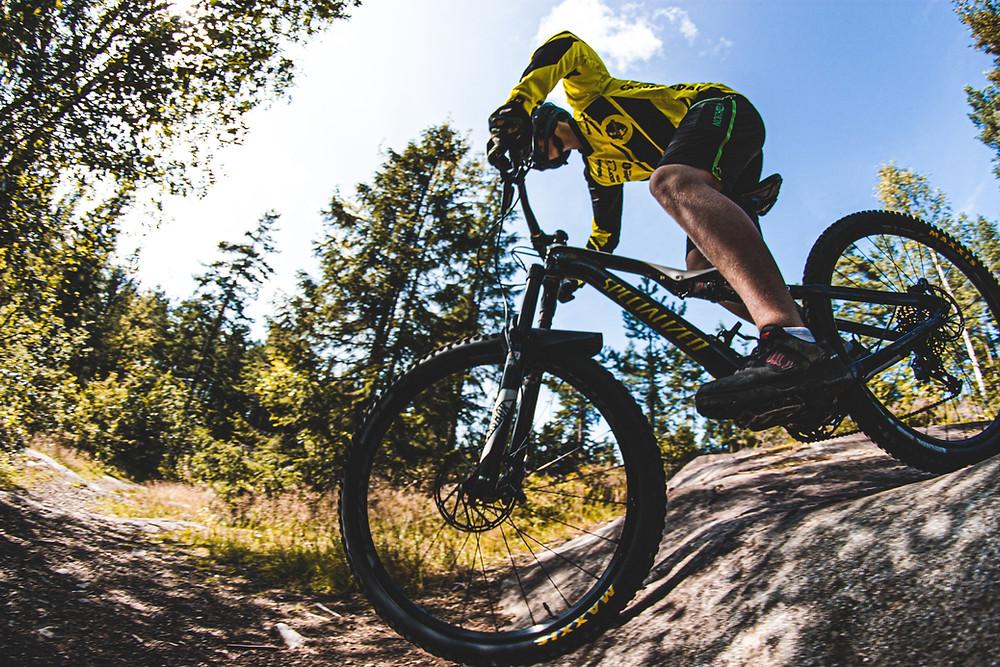 Mountain Biker going over a rock