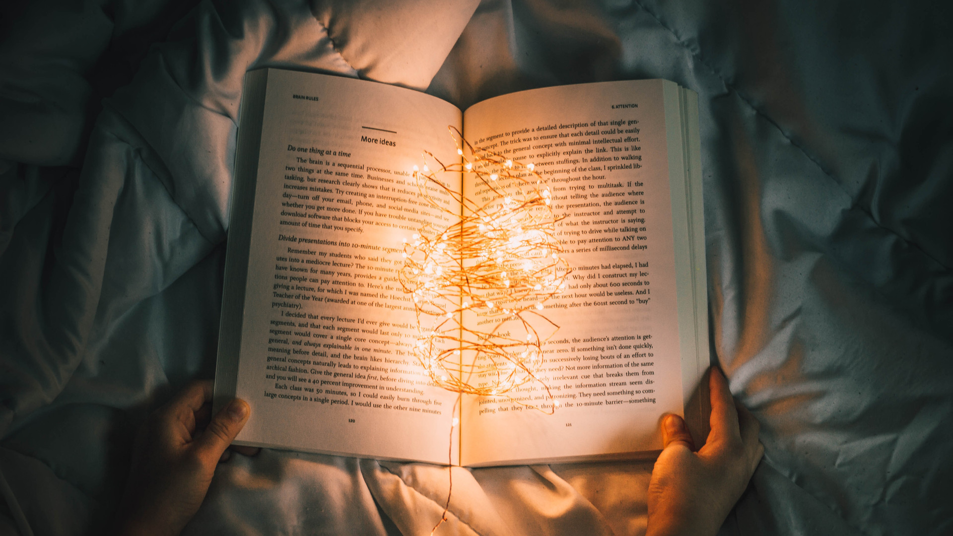 Book with fairy lights in the middle, illuminating the words