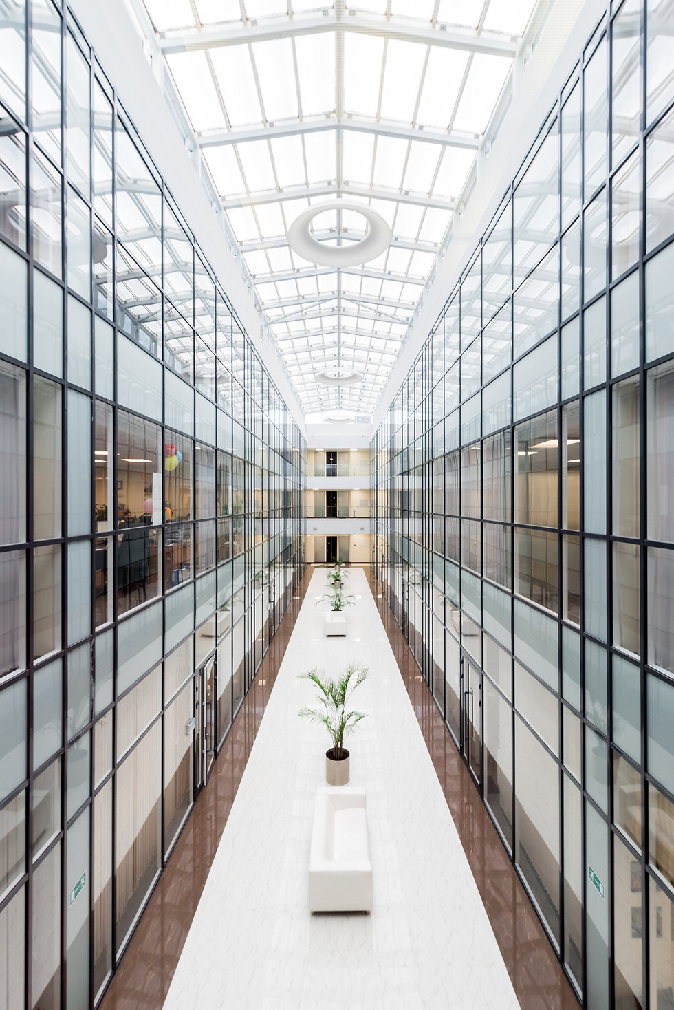 inside of a business building with glass panes for walls