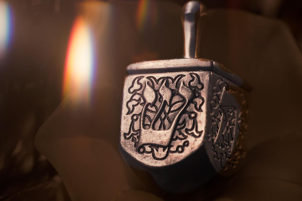 Ornate silver dreidel