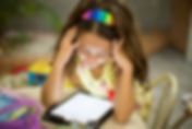 Online Learning with Seesaw slide: Smiling girl using tablet.