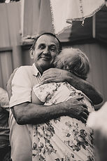 An old couple hugging