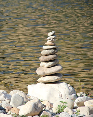 Rocks balancing by the water
